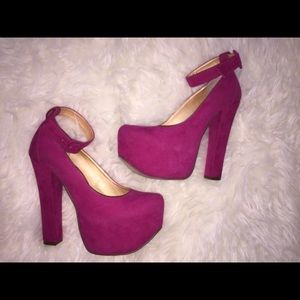 Hot pink suede pumps with ankle strap.