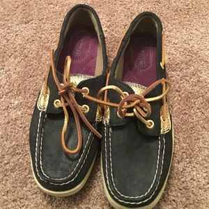 Black and gold Sperry shoes