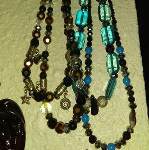 $20ec. Orange, Silver moon/stars double necklace