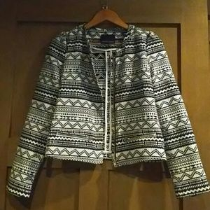 Patterned jacket with silver zippers