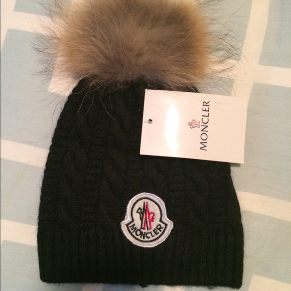 Kids Moncler hat Black in color. M 56a80136713fdeb239001c23 e5698400427