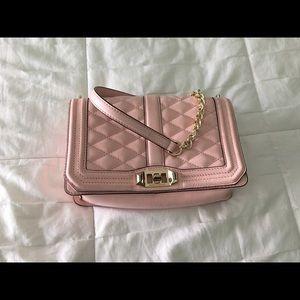 Rebecca Minkoff pink cross body bag.