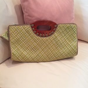 Beautiful woven bag with wooden handles