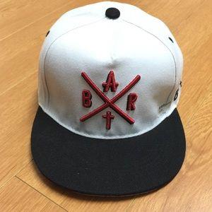 """BRAT"" Embroidered Flat Bill Snap Back Cap"