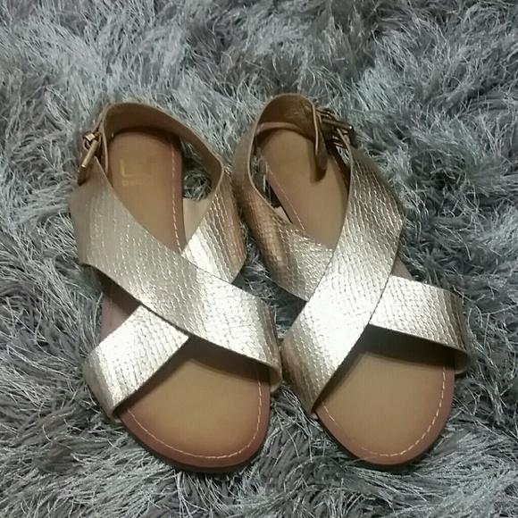 c69dcd7910e ALDO Shoes - Metallic Rose Gold Criss Cross Sandals