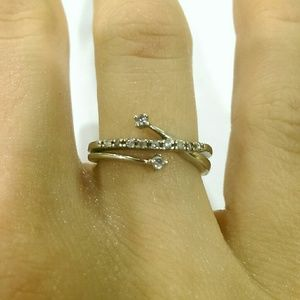White gold ring with diamond accents, size 5.5