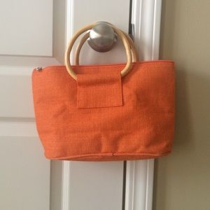 Rattan tote with wooden handles