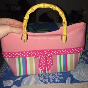 pink purse with bow and wooden handles