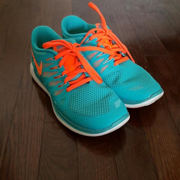 831feb9eeb0e2 Teal and Neon Orange Nike Free Run 5.0. M 56afb5904225be09c700581e