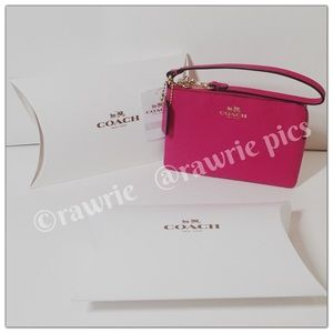 New Coach pink leather wristlet with gift box