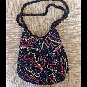 Linea Pelle Handbags - Vintage beaded bag.  Excellent shape.