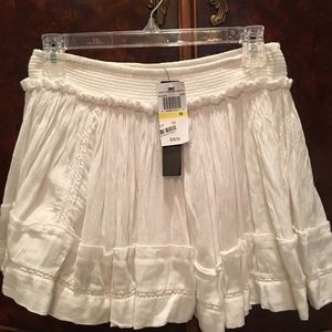 Joe & Elle Dresses & Skirts - White skirt from MACYS new with tags and pop label