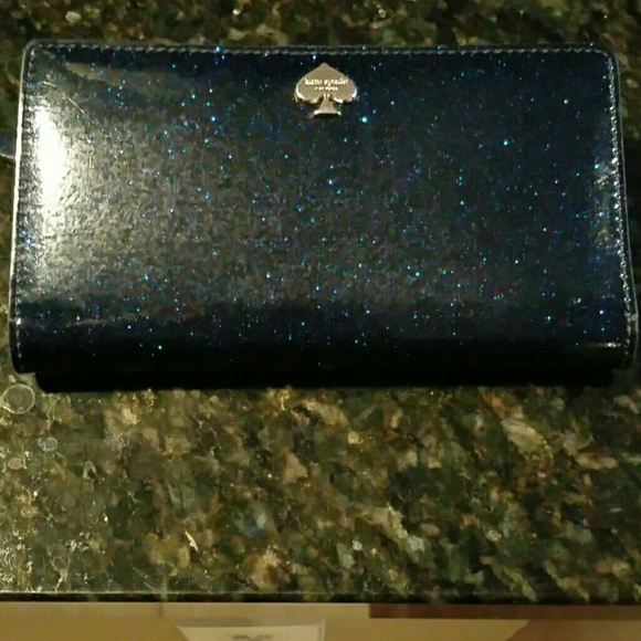 kate spade Handbags - Kate Spade blue glitter wallet just reduced