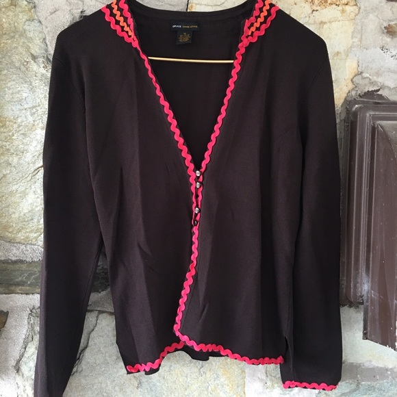 brown cardigan with pink ribbon details