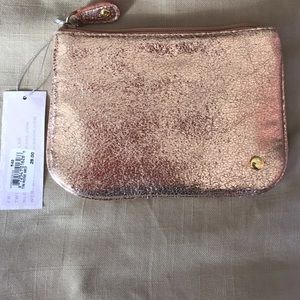Stephanie Johnson rose gold clutch