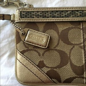 COACH monogram print and leather wristlet