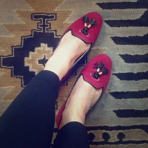 Suede loafer with leather tassels