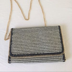 Tarnish Handbags - Tarnish Zig Zag print fold over clutch bag.