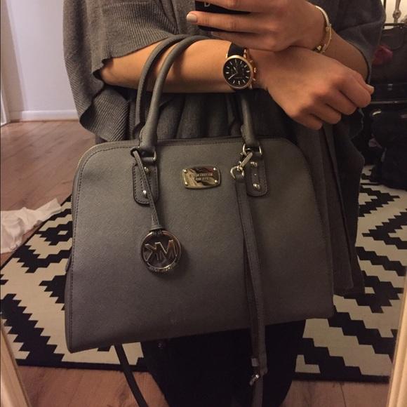 9a66ed586dd3 Michael Kors pearl grey Saffiano leather satchel. M 56b9750b291a358a08017159