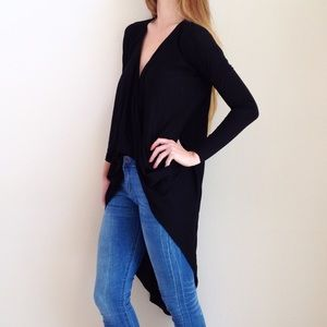 | new | surplice high low top