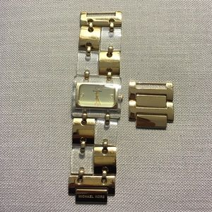 Michael Kors gold and clear acrylic watch.