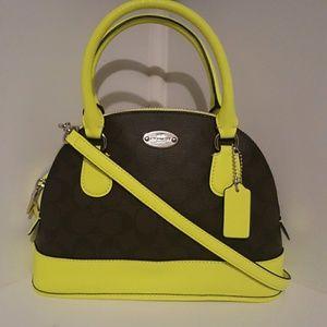 A Coach mini handbag or crossbody