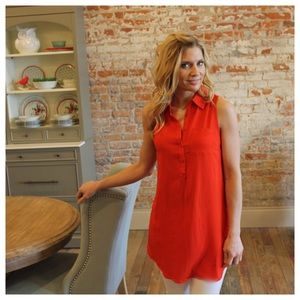 Red sleeveless button front tunic