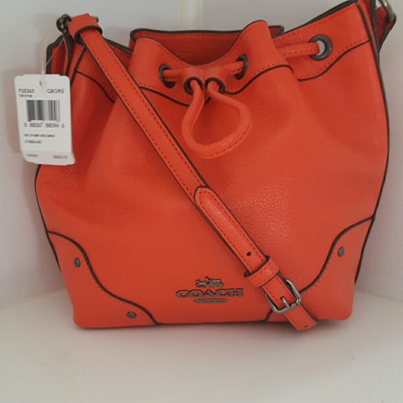 15% off Coach Handbags - Mini Coach drawstring bucket purse. from ...