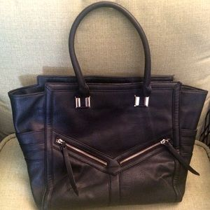 Edgy black leather tote bag