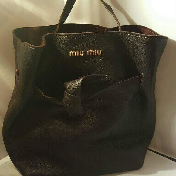 MIU MIU PRADA Chocolate Pebbled Leather Bucket. M 56c7ea69522b45a054014565 2a89424bc7d08