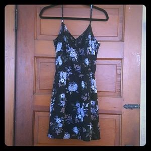 Floral, lined black dress.