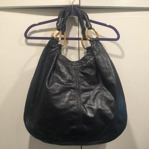Miu Miu black hobo bag. M 56bfb17ff0928253ac03540e b00c3f3c69a4e