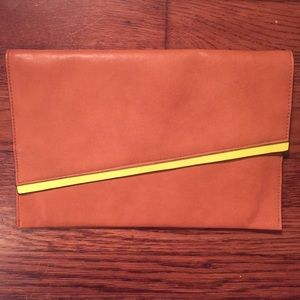 Tan colored clutch with neon yellow detail
