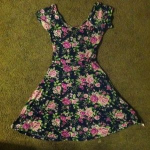 An opened back floral pink and purple dress 