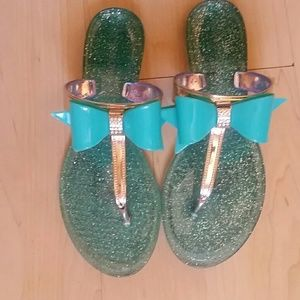 Turquoise bow jelly sandals