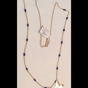 Beautiful Macy's Gold Necklace with Blue beads.