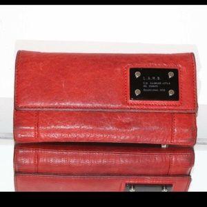 L.A.M.B red clutch wallet