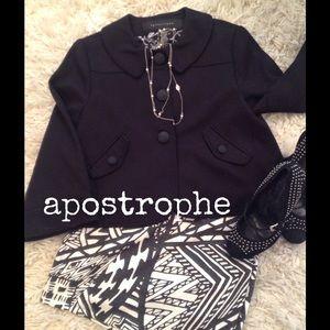 Apostrophe cropped swing jacket.