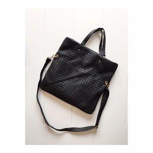 Black woven fold over purse