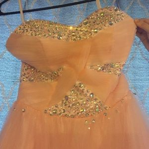 Peach puffy prom dress