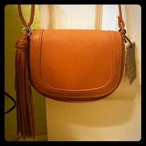 Cross body light brown purse.
