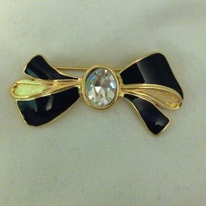 Cute vintage black and gold bow brooch