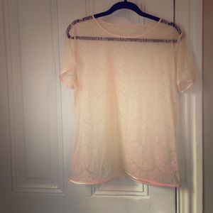 Sheer lace tee with pink silk trim
