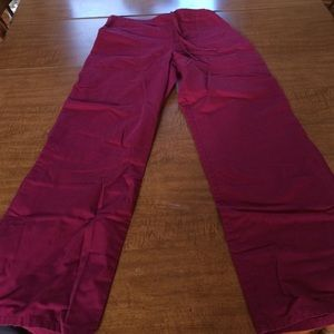 Fuchsia drawstring scrub pants.
