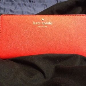 NWOT Kate Spade wallet-red and absolutely fab!