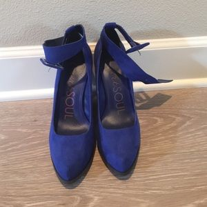 Bright blue platform pumps with ankle strap