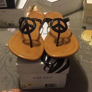 Nine West Shoes - Peace symbol flip flops e867ab890