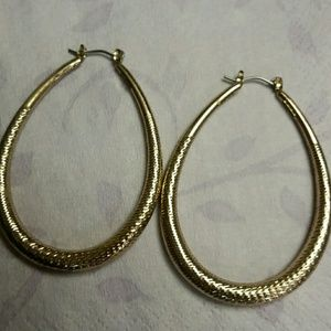 Gold tone oval hoop earrings