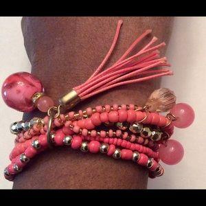 Orange bead bracelet with tassel
