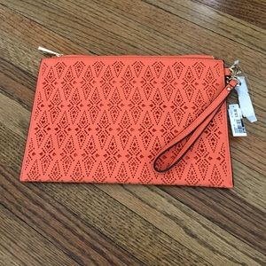 ALDO Clutches & Wallets - Aldo orange laser cut clutch.